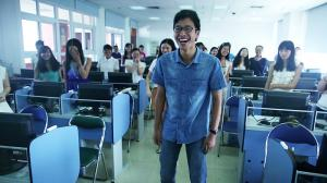 Student laughing at Jinan University in Guangzhou, China.