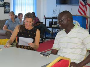[Click to Enlarge] Adrie Kusserow looks over writing during a one-on-one workshop session in South Sudan.