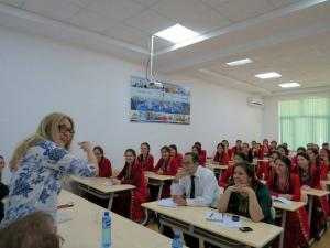Novelist Ann Hood engages with students at International Turkmen Turkish University.