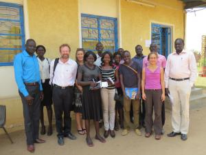[Click to Enlarge] Chris Merrill, Adrie Kusserow, and Catherine Filloux with students and professors at the University of Juba.