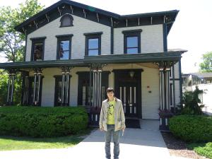 Jacob Oet in front of Dey House, home of the Iowa Writers' Workshop, where he is attending a 3-week intensive poetry workshop.