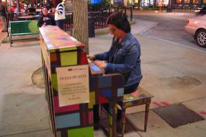 (Click to Enlarge) Mahsa Mohebali (Iran) treating passersby to an impromptu concert on one of Iowa City's public pianos.