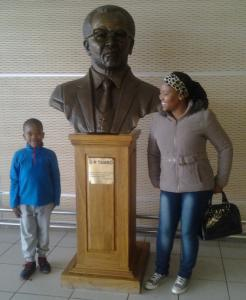 Mokae's son, Mpho, and wife, Kelesitse, waiting at the airport in Johannesburg, South Africa.