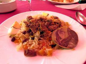 Plov, the national dish of Uzbekistan (the round meat at right is horse)