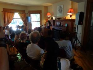 (Click to Enlarge) Whiti Hereaka (New Zealand) reads to a packed crowd at Shambaugh House.