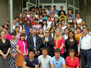 The group with writing workshop students on the steps of the school in Angren