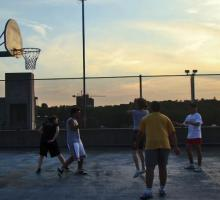 Shooting hoops at sunset.