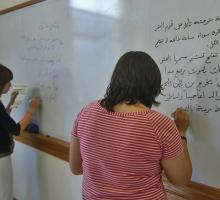 Showing off skills at the Arabic-language workshop.