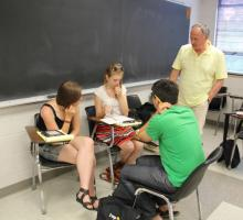 BTL Russia instructor Alan Cherchesov (IWP '11, Russia) checks on students' work.