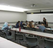 Guest lecturer and Palestinian-American author Ibtisam Barakat leads a class.