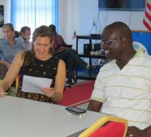 Adrie Kusserow looks over writing during a one-on-one workshop session in South Sudan..jpg