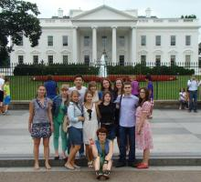 Participants pose in front of the White House in Washington D.C.