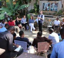 Chris Merrill introduces our program at the Haiti PEN Center.jpg