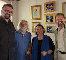 Emre Erdem, Nigol Bezjian, and Christopher Merrill with Esin Celebi Bayru the great granddaughter, 21 generations removed, of Rumi.jpg