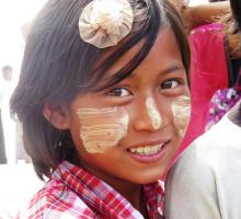 16-Girl with Thanakha (traditional face painting). Many women (and men) do this because it cools the skin, acts as sun block, and leads to more beautiful skin..jpg