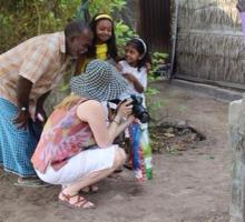Jamby Djusubalieva shares her photo with a local family during the group's tour of a local island.jpg