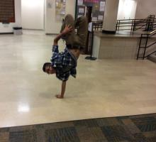 BTL participant Johnny breakdances in the dormitory.