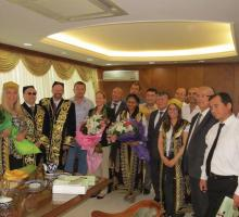 8-Meeting with members of the Uzbekistan Writers Union (American writers donning traditional robes and hats).jpg