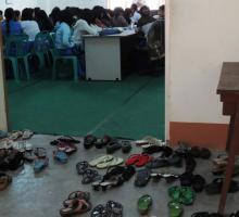 21-Students shoes outside the classroom at Dagon University.jpg