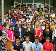1-The group with writing workshop students on the steps of the school in Angren, Uzbekistan.jpg