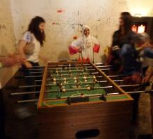 Participants playing a game of foosball.