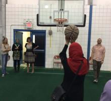 Participants play basketball at a local mosque.