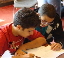 Students study poetry in Arabic and English.