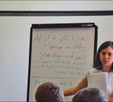 Instructor Anjali Sachdeva compares Arabic and English texts.