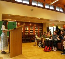 Students give a reading at the Dey House, home to the Writers' Workshop.