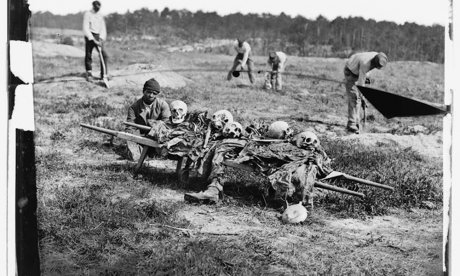 African Americans burying the corpses of soldiers on the Cold Harbor battlefield, 1865.